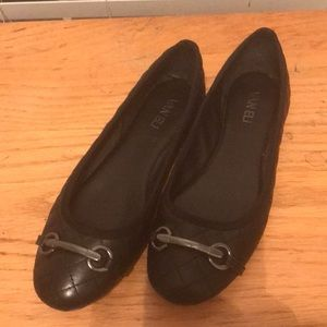 Black quilted leather Van Eli flats. Size 7